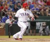 Texas Rangers Josh Hamilton follows though on a two-run triple against Oakland Athletics pitcher Tommy Milone in the first inning of their MLB American League baseball game in Arlington, Texas Septemb