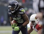 Seattle Seahawks' Richard Sherman (25) intercepts a pass meant for Arizona Cardinals' Larry Fitzgerald (11), returning it for a touchdown during the second quarter of their NFL football game in Seattl