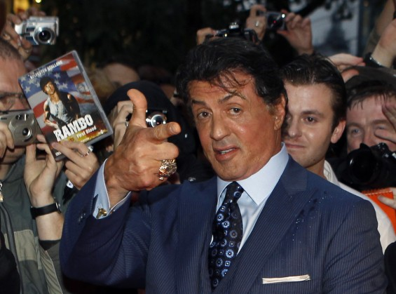 "U.S. actor Sylvester Stallone poses with fans as he arrives for the German premiere of his movie ""The Expendables"" in Berlin in this August 6, 2010 file photo. A federal judge has reaffirmed his decis"