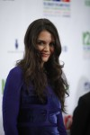 Actress Katie Holmes poses during the &#034;12-12-12&#034; benefit concert for victims of Superstorm Sandy at Madison Square Garden in New York, December 12, 2012. 