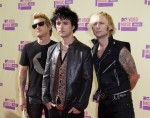 The Rock group Green Day, Mike Dirnt, (L), Billie Joe Armstrong, (C), and Tre Cool arrive for the 2012 MTV Video Music Awards in Los Angeles, September 6, 2012.