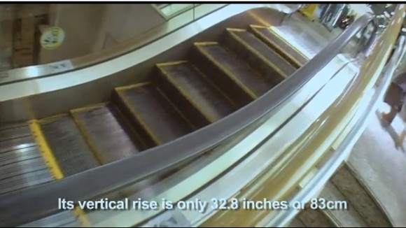 A video of the world's shortest escalator posted to YouTube is going viral with more than 500,000 views in one day.