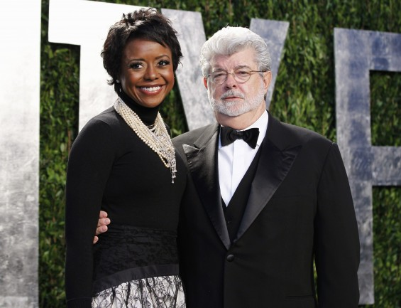 Director George Lucas and his partner Mellody Hobson arrive at the 2012 Vanity Fair Oscar party in West Hollywood, California in this February 26, 2012, file photo. Lucas has become engaged to his lon