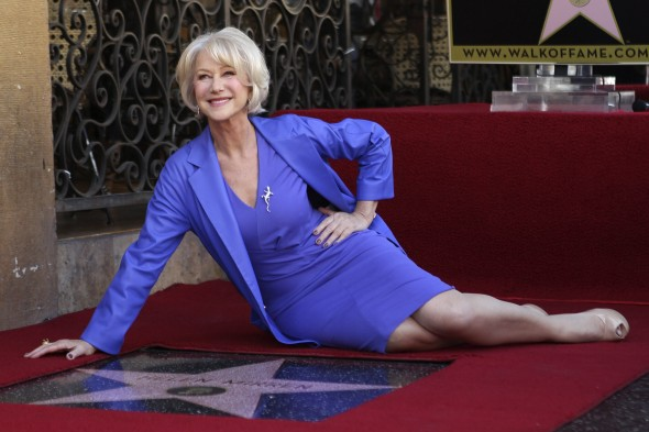 helen-mirren-poses-with-her-newly-unveiled-star-the-2-488th-star-on-the-hollywood-walk-of-fame-in-hollywood-california-january-3-2013-the-multi-major-award-winning-actress-was-recently-nominated