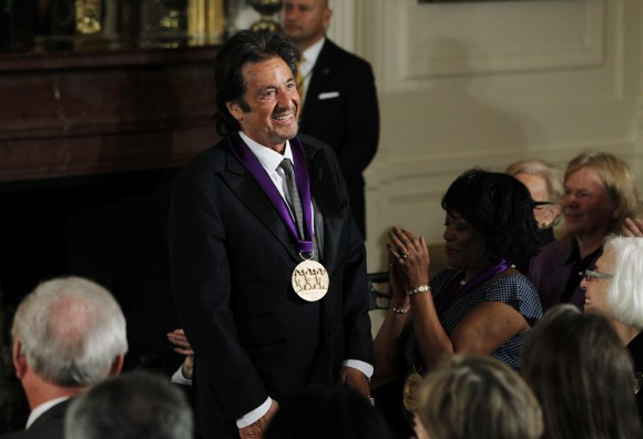 National Medal of Arts recipient, actor Al Pacino acknowledges the applause after receiving the medal from U.S. President Barack Obama at a ceremony in the East Room of the White House in Washington,
