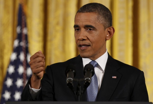 U.S. President Barack Obama gestures while addressing his first news conference since his reelection, at the White House in Washington November 14, 2012.