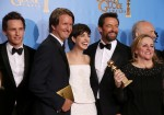 "The cast and crew of ""Les Miserables"" (From L) actor Eddie Redmayne, director Tom Hooper, Anne Hathaway, Hugh Jackman and producer Debra Hayward celebrate their win for Best Motion Picture, Comedy or"