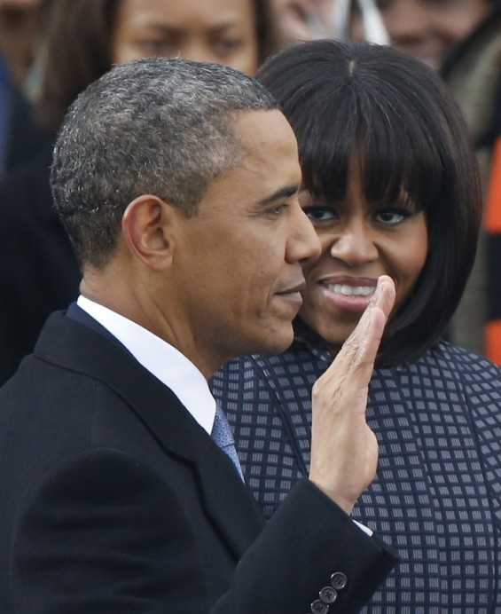 U.S. President Barack Obama recites his oath of office as first lady Michelle Obama looks on during swearing-in ceremonies on the West front of the U.S Capitol in Washington