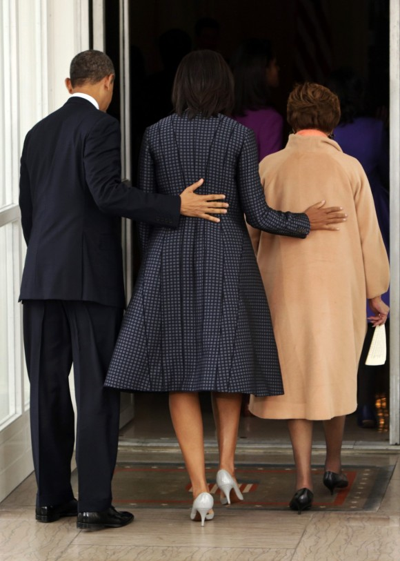 U.S. President Barack Obama (L) arrives back at the White House with First Lady Michelle Obama (C) and Michelle Obama's mother Marian Robinson (R) in Washington January 21, 2013, after attending servi
