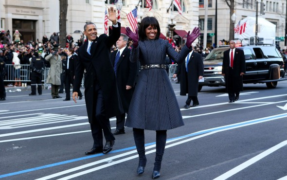 u-s-president-barack-obama-and-first-lady-michelle-obama-wave-during-the-inaugural-parade-from-the-u-s-capitol-to-the-white-house-in-washington-january-21-2013
