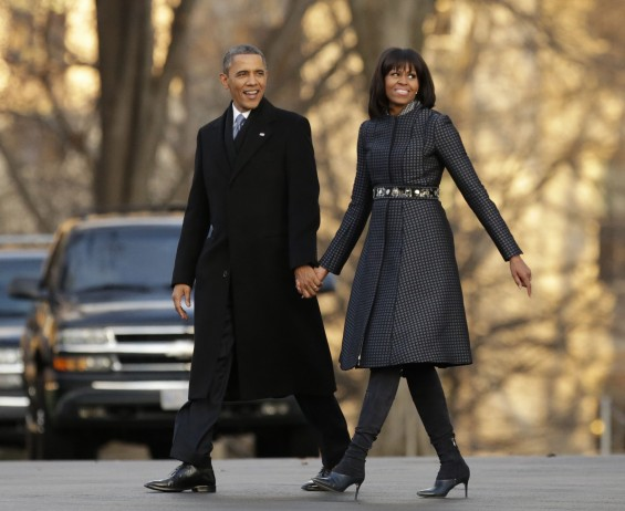 U.S. President Barack Obama and First Lady Michelle Obama walk from the White House to the Inaugural Parade reviewing stand in Washington January 21, 2013, after returning from The Capitol for Obama&#039;s