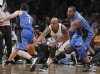 Brooklyn Nets forward Keith Bogans (10) cuts between Orlando Magic guard J.J. Redick (7) and forward Glen Davis (11) to steal the ball in the fourth quarter of their NBA basketball game in New York, J