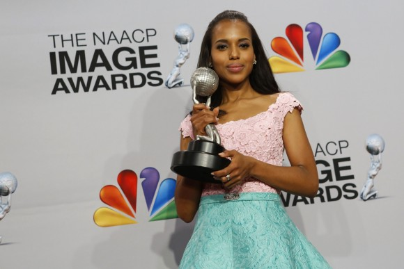 Actress Kerry Washington holds her award in the press room at the 44th NAACP Image Awards at the Shrine Auditorium in Los Angeles, California, February 1, 2013.