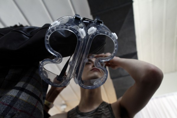 A model is seen through a pair of goggles before the Degen Autumn/Winter 2013 collection show during New York Fashion Week, February 6, 2013.