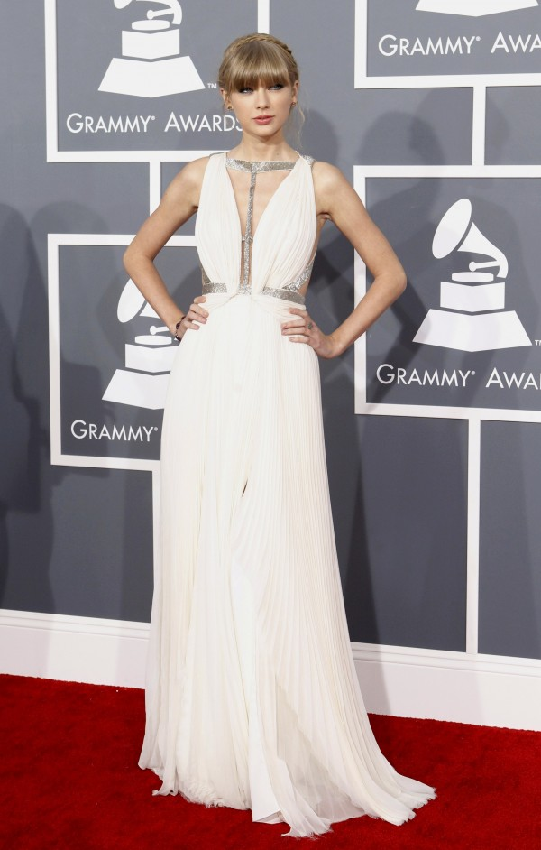 Singer Taylor Swift poses as she arrives at the 55th annual Grammy Awards in Los Angeles, California February 10, 2013.