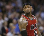 Miami Heat forward LeBron James reacts after being called for a technical foul against the Oklahoma City Thunder in the first half of their NBA basketball game in Oklahoma City, Oklahoma February 14,