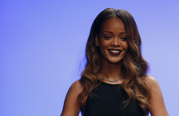Singer Rihanna walks out onto the catwalk after the presentation of her Rihanna for River Island Autumn/Winter 2013 collection during London Fashion Week, February 16, 2013.