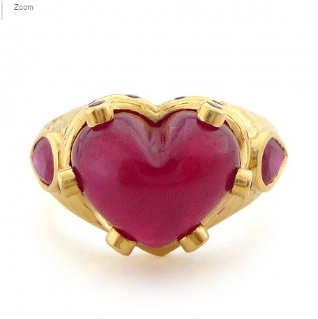 "A heart-shaped ring by Daniel Gibbings listed on his website (the ""20 K Petite Gold Cabochon Ruby Heart Ring"") is seen in this image. The ring is very similar to the one Katy Perry was wearing on Vale"