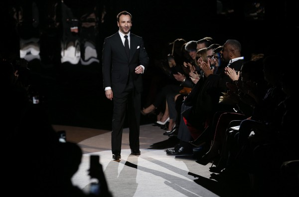 Designer Tom Ford walks on the catwalk following the presentation of the Tom Ford Autumn/Winter 2013 collection during London Fashion Week, February 18, 2013.