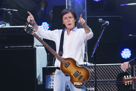 "Musician Paul McCartney performs during the ""12-12-12"" benefit concert for victims of Superstorm Sandy at Madison Square Garden in New York, December 13, 2012."