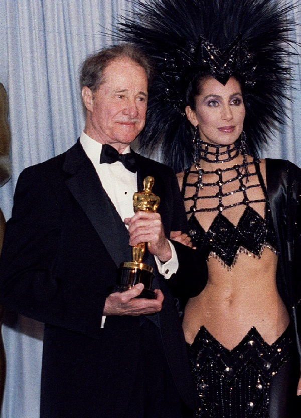 "Actor Don Ameche has died Dec. 6 of cancer at age 85. Don Ameche stands next of Cher with his Oscar for best supporting actor in ""Cocoon"", March 24, 1986"