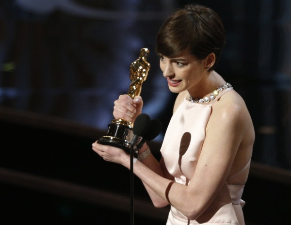Anne Hathaway accepts the award for best supporting actress for her role in &#034;Les Miserables&#034; at the 85th Academy Awards in Hollywood, California February 24, 2013.