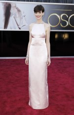 "Anne Hathaway, best supporting actress nominee for her role in ""Les Miserables"", poses in a Prada light pink duchesse satin backless column gown and Tiffany diamonds as she arrives at the 85th Academy"