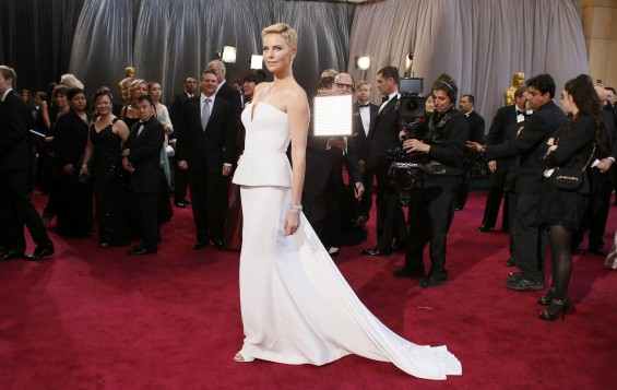 Actress Charlize Theron wearing white Dior Haute Couture column gown arrives at the 85th Academy Awards in Hollywood, California February 24, 2013.