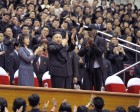North Korean leader Kim Jong-Un (C), his wife Ri Sol-Ju (L) and former NBA basketball player Dennis Rodman clap during an exhibition basketball game in Pyongyang in this undated picture released by No