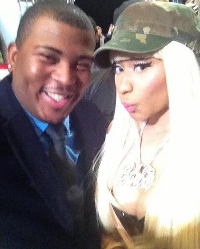 """American Idol"" contestant Curtis Finch Jr. and Nicki Minaj pose for a photograph."