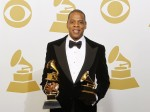 Jay-Z poses with the awards he won for Best Rap Performance, Best Rap/Sung Collaboration and Best Rap Song backstage at the 55th annual Grammy Awards in Los Angeles, California February 10, 2013.