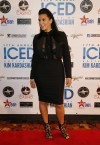 Reality TV star Kim Kardashian poses on the red carpet before the start of the Cowboy's Iced event in Calgary, Alberta January 4, 2013. Kardashian, who recently announced she was having a baby with ra