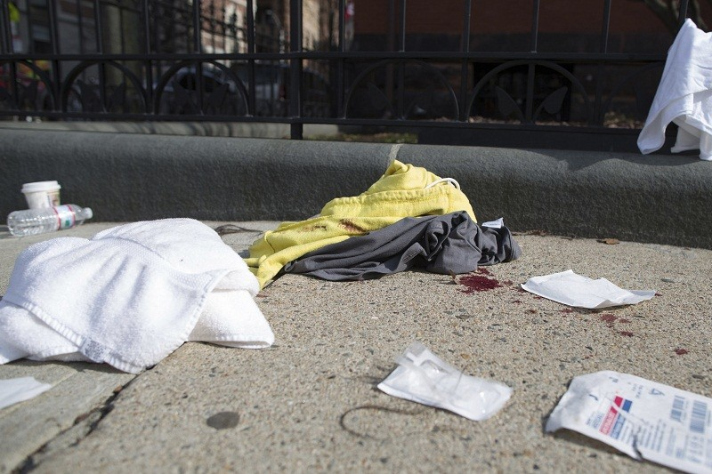 Bloody clothing and medical pads are found on Commonwealth Avenue in Boston near the scene of multiple explosions near the end of the Boston Marathon finish line in Boston, Massachusetts April 15, 201