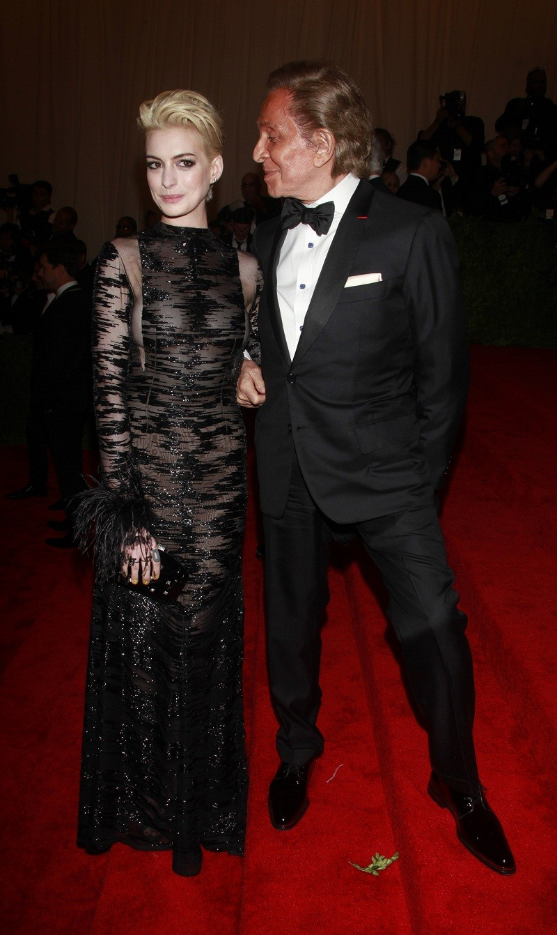 """Actress Anne Hathaway and fashion designer Valentino arrive at the Metropolitan Museum of Art Costume Institute Benefit celebrating the opening of """"PUNK: Chaos to Couture"""" in New York, May 6, 2013."""