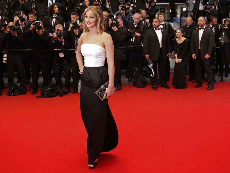 Actress Jennifer Lawrence poses on the red carpet as she arrives for the screening of the film 'Jimmy P.' (Psychotherapy of a Plains Indian) in competition at the 66th Cannes Film Festival in Cannes M