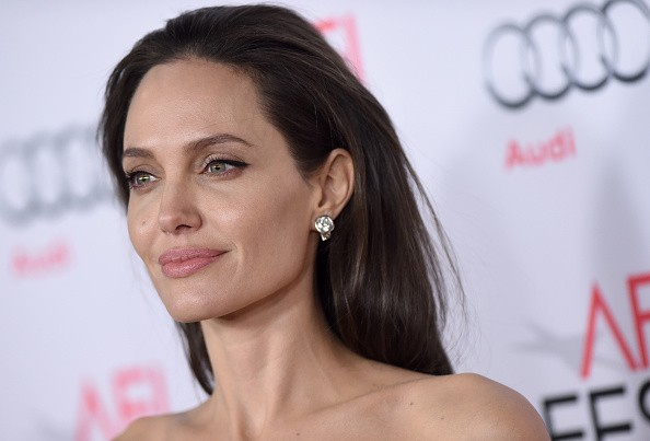 The 42-year old daughter of father Jon Voight  and mother Marcheline Bertrand, 169 cm tall Angelina Jolie in 2017 photo