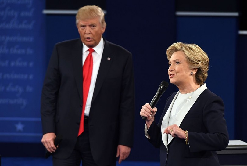 US Democratic presidential candidate Hillary Clinton and US Republican presidential candidate Donald Trump debate during the second presidential debate at Washington University in St. Louis,