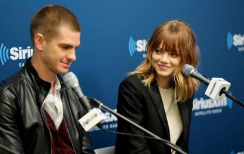 Actors Andrew Garfield (L) and Emma Stone of the cast of 'The Amazing Spider-Man 2' answer questions from fans during a SiriusXM 'Town Hall' special with host Jamie Foxx.