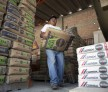 A worker stacks bags of Cemex SAB's Tolteca brand cement at a distribution center in Barrientos in the state of Mexico on Wednesday, July 24, 2013.