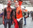 Attendees in costume as Spider-Man and Deadpool on Day 1 of MCM London Comic Con at The London ExCel on May 27, 2016 in London, England.