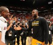 Dwyane Wade #3 of the Miami Heat and LeBron James #23 of the Cleveland Cavaliers are seen after the game on March 19, 2016 at AmericanAirlines Arena in Miami, Florida.