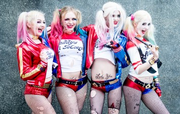 Cosplayers as Harley Quinn from Suicide Squad pose on day 1 of the MCM London Comic Con at ExCel on October 28, 2016 in London, England.