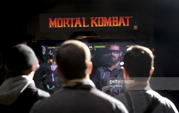 Attendees play Mortal Kombat 3D on Sony Corp. PlayStation 3 consoles during a game developers conference in San Francisco, California, U.S., on Wednesday, March 2, 2011.