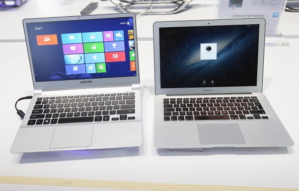 An ultra thin Samsung Notebook Series 9 laptop computer (L) runnung Microsoft Windows 8 sits next to an Apple Macbook Air.