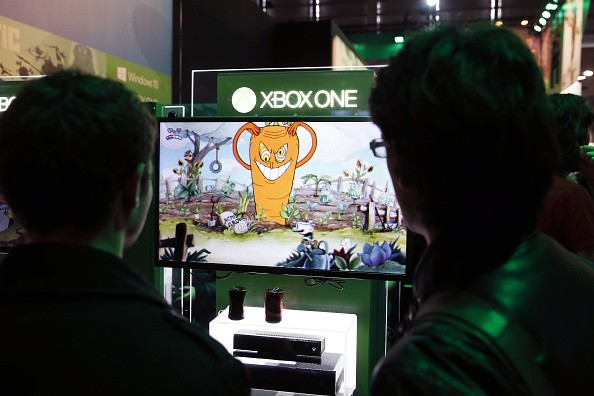 A visitor plays a game on a XBox One on October 28, 2015 at the Paris Game Week, a trade fair for video games in Paris.