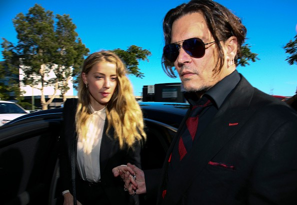 US actor Johnny Depp (R) and his wife Amber Heard arrive at a court in the Gold Coast on April 18, 2016.