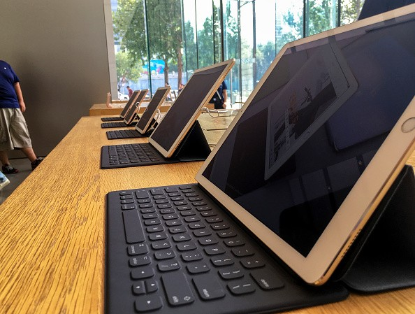 IPad Pro on table in an Apple shop. As Chinese smartphone...