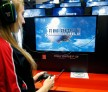 A woman plays the video game 'Final Fantasy XV' developed and published by Square Enix during the 'Paris Games Week' on October 28, 2016 in Paris, France.