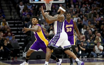 DeMarcus Cousins against Nick Young and Julius Randle