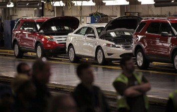 A worker assembles Ford vehicles at the Chicago Assembly Plant on December 1, 2010 in Chicago, Illinois.The plant builds the Ford Taurus, Explorer and Lincoln MK X.